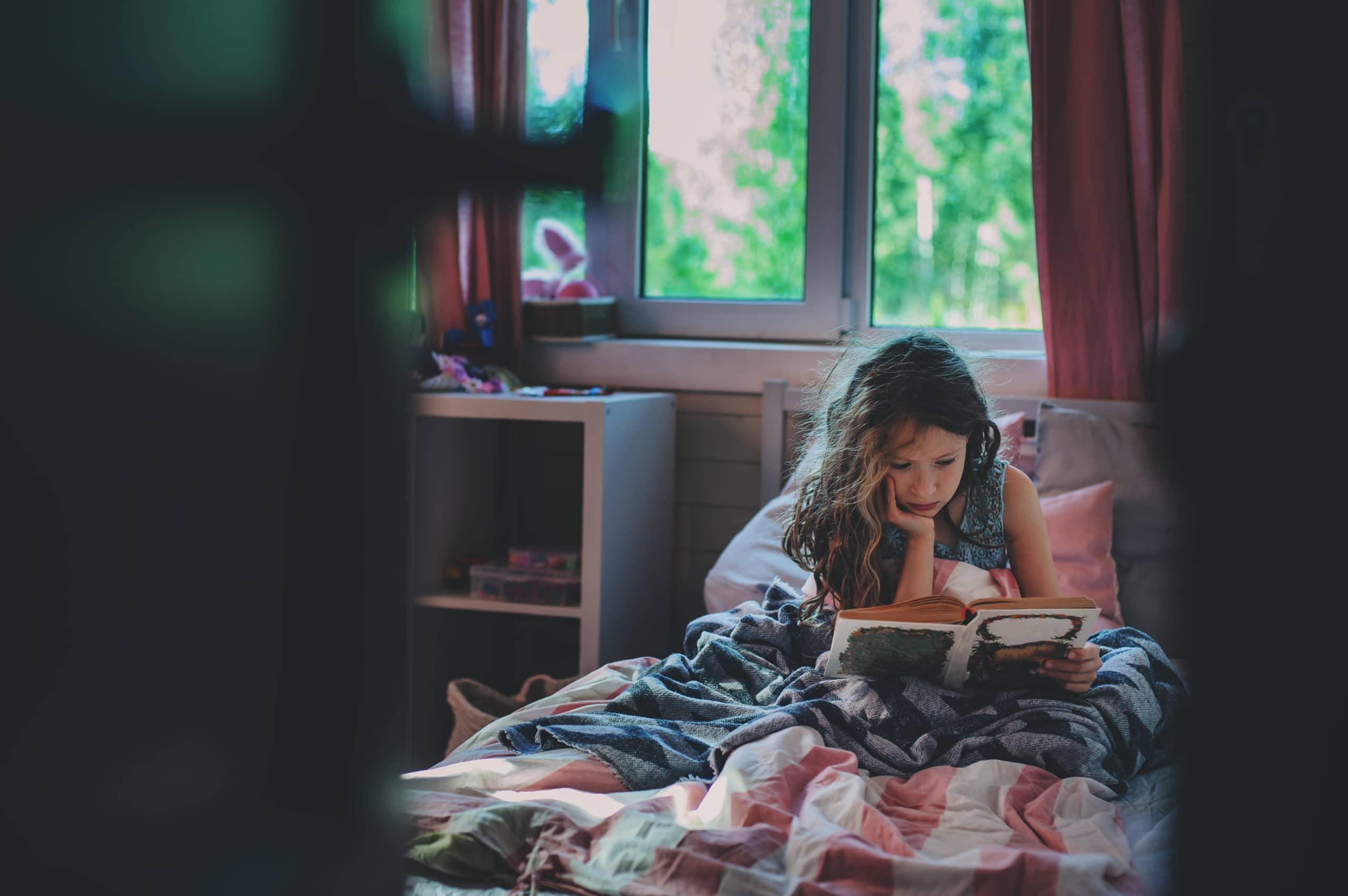 sad kid reading books help